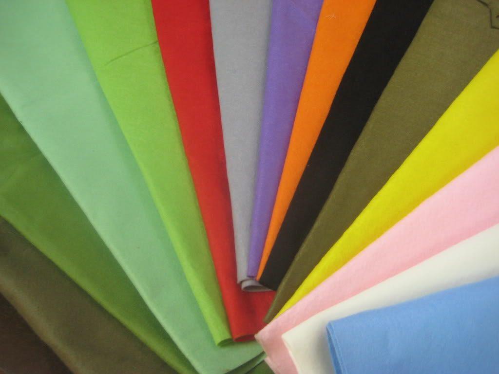 nhiều tấm vải màu xếp lên nhau