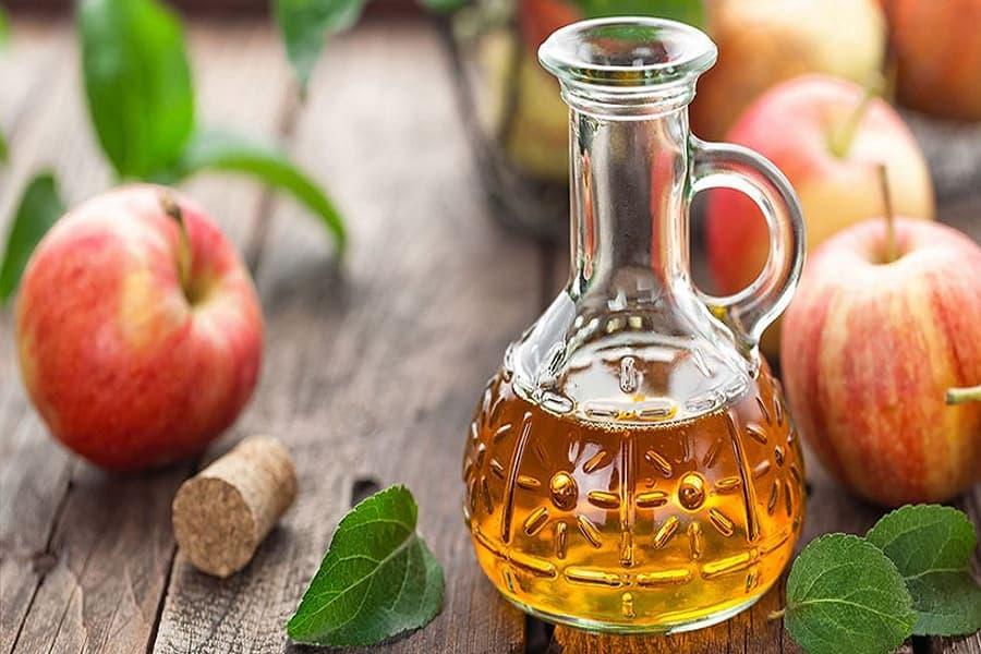 giấm táo trị đau gót chân hiệu quả