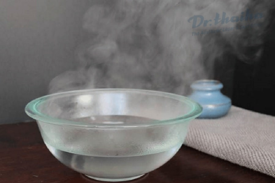 ngâm nước nóng trị mụn cóc